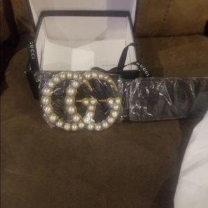 Oversized Black Gucci Pearl belt.